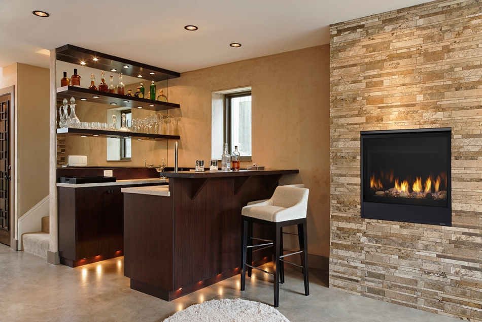 Wet bar and fireplace in modern home